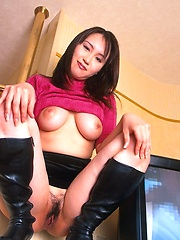 Busty Japanese enjoys a dildo in her pussy
