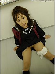 Amazing japanese schoolgirl posing in the classroom