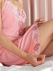 Rina Itoh Asian shows sexy legs under pink lingerie before sleep