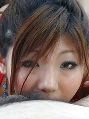 Mahiru Tsubaki Asian rubs phallus with feet and licks jewells